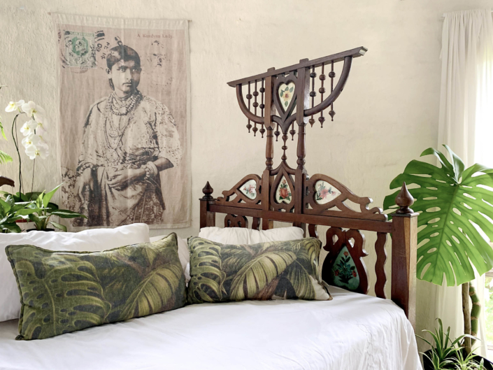 Harem Bed with linen throw and scatter cushions