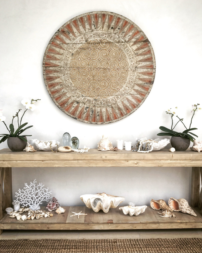Penthouse dresser with shells and wall hanging
